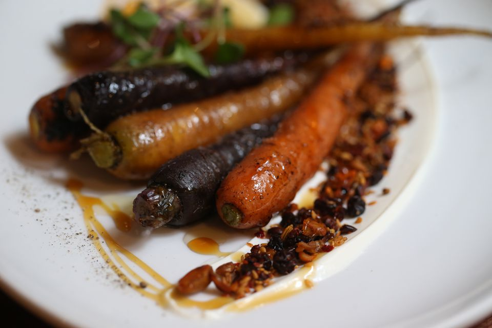 Whole grilled carrots are served with yogurt, honey, and a mixture of pistachios and other seeds at Alden & Harlow.