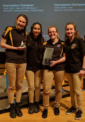 Alexandra (left) with her robotics teammates, who called themselves the Powerpuff Girls.