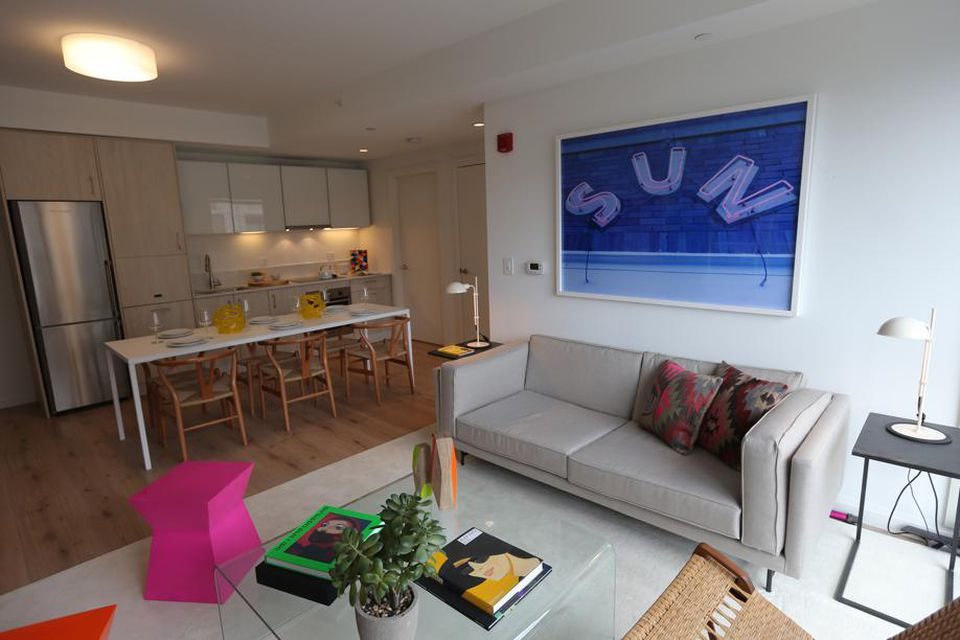 The apartments feature 9-foot ceilings and recessed lighting.