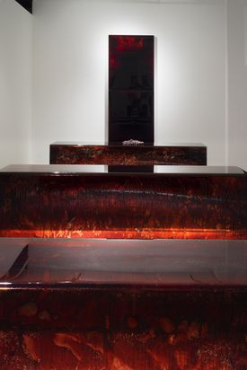 """An installation view of  """"CONFIGURATION"""" and """"UNTITLED (BLOOD MIRROR)"""" by Jordan Eagles."""