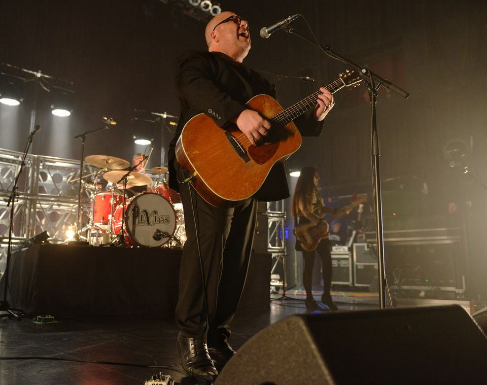 Pixies frontman Black Francis, drummer David Lovering, and bassist Paz Lenchantin onstage at the House of Blues.