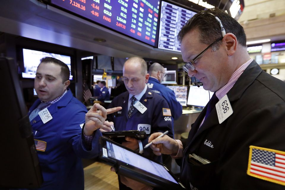 Specialist Gennaro Sapolito worked with traders at his post on the floor of the New York Stock Exchange on Tuesday.