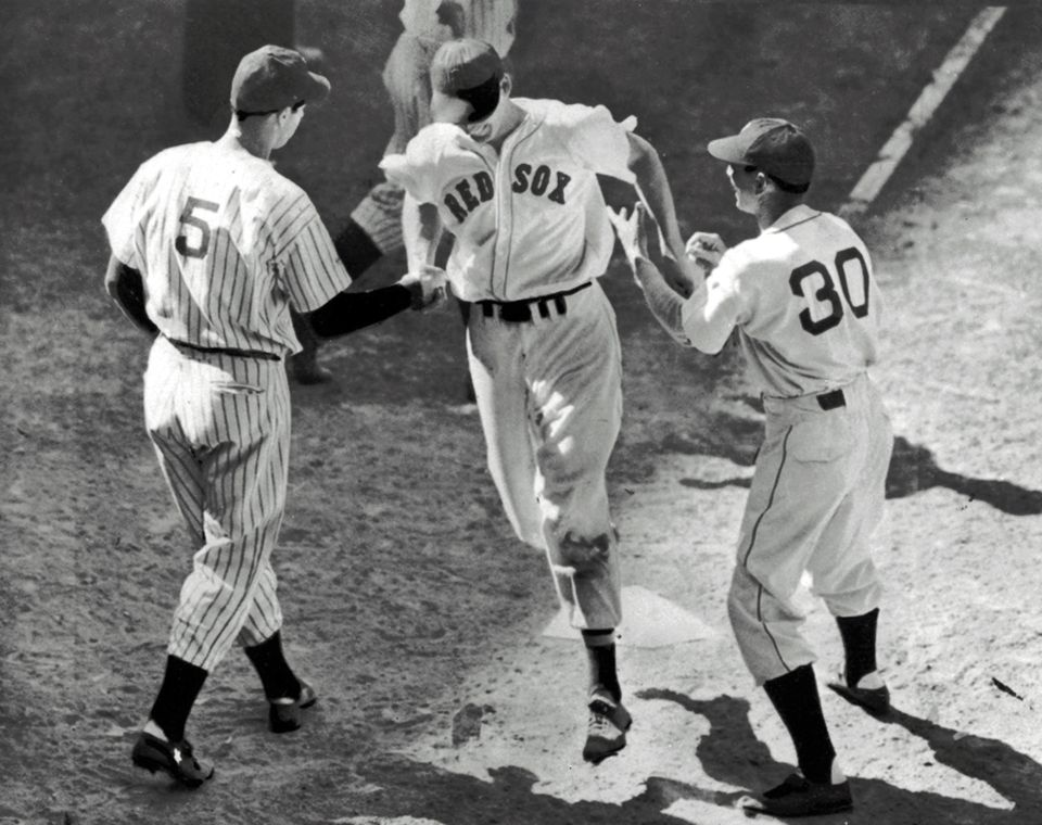 Ted Williams (center) was greeted at the plate by Joe DiMaggio (5) and coach Marv Shea after hitting a dramatic ninth-inning home run to give the American League a 7-5 victory in the 1941 All-Star Game in Detroit.