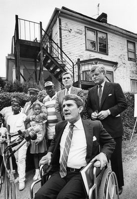 Deland spoke during the announcement of an E.P.A. soil cleanup program outside the home of the Jones family in Dorchester. Deland was joined by US Senator Ted Kennedy, right, Boston Mayor Ray Flynn, standing center, and members of the Jones family, standing left.