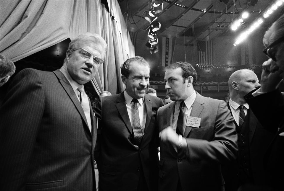 """Roger Ailes (center right) with Richard Nixon in 1968 in a scene from """"Divide and Conquer: The Story of Roger Ailes."""""""