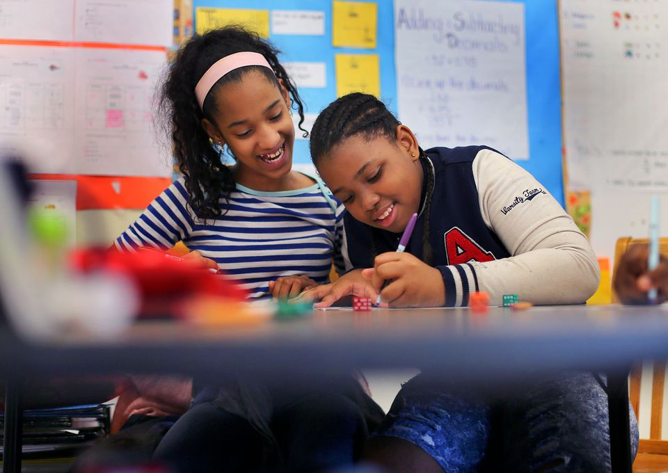 Sonia Luzon (left), 12, and Shawniya Smith, 11, worked on a math problem at the Dever Elementary School.
