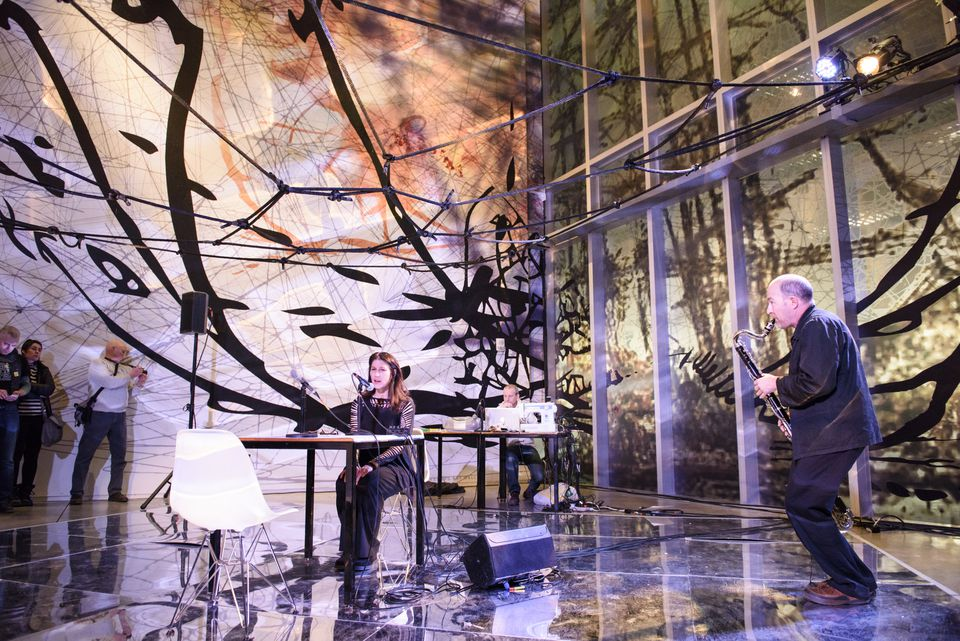"""Matthew Ritchie's """"The Long Count/The Long Game"""" featured a 12-member orchestra, guitarists and vocalists, and digital animation projections."""