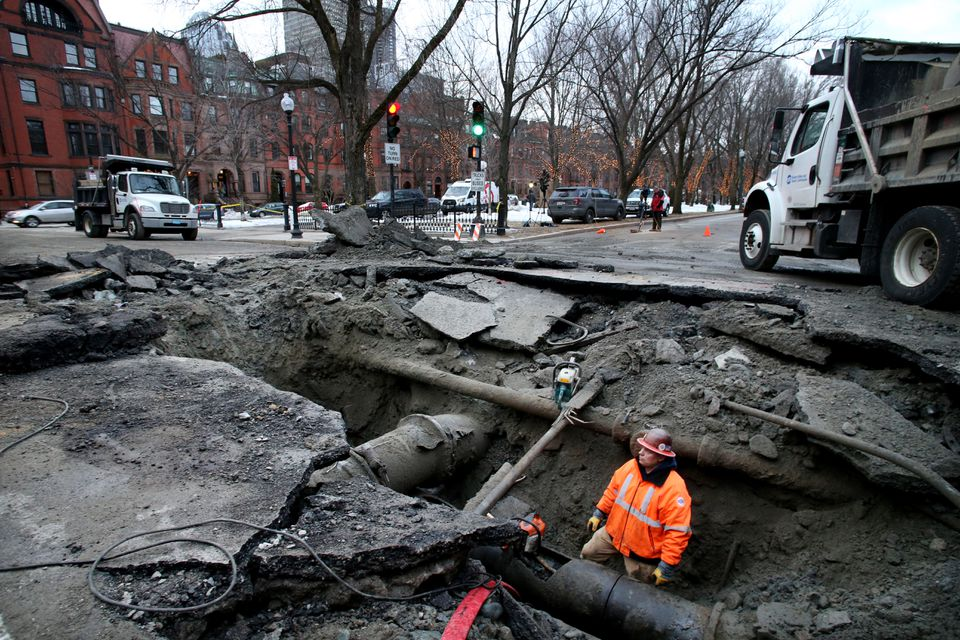 A crew worked to repair a water main break at the intersection of Commonwealth Avenue and Exeter Street in Boston on Tuesday.