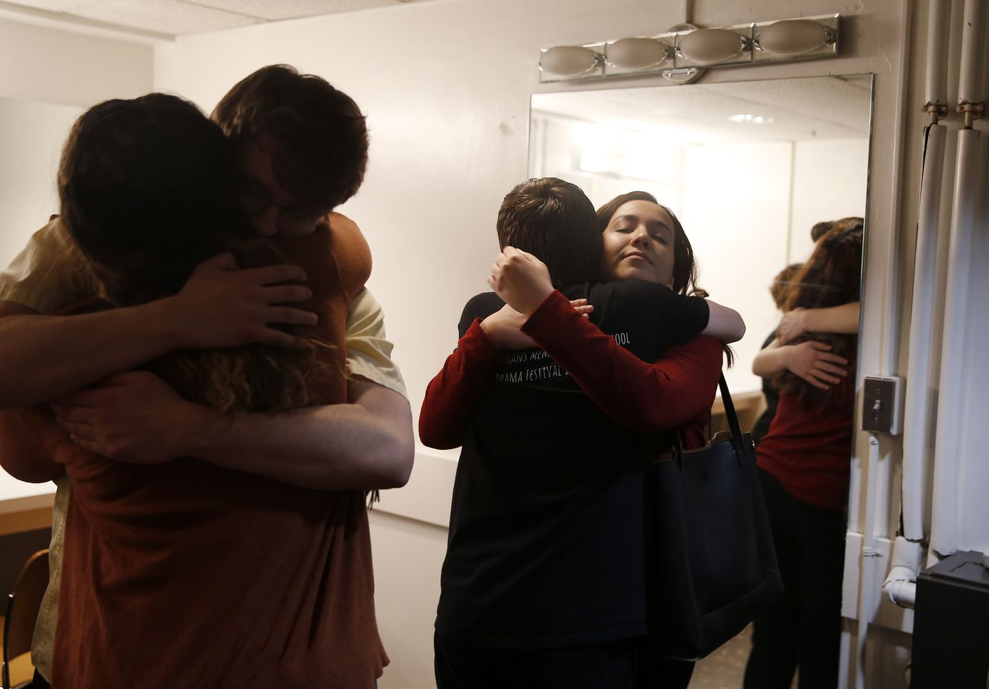 Moments before their final performance at the state drama festival, Deb embraced her fellow cast members.
