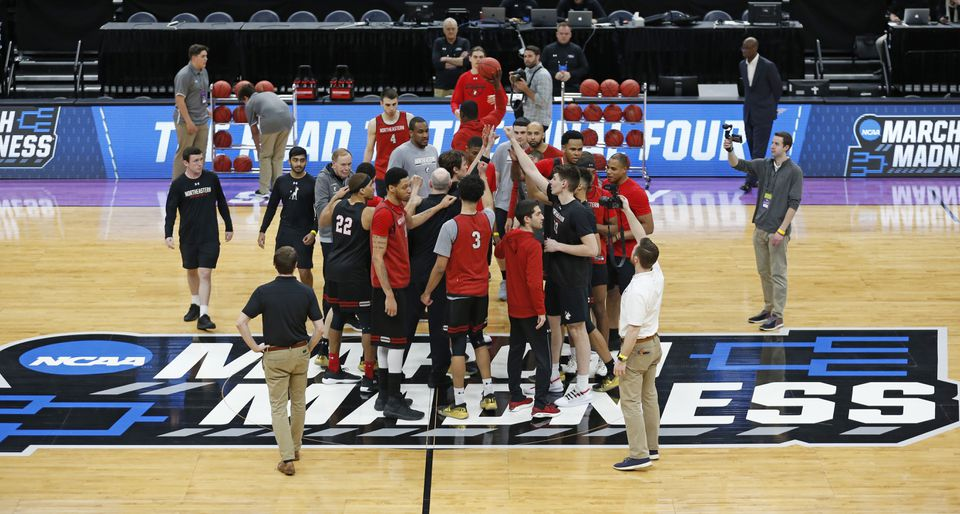 Northeastern players gather for a photograph during their Wednesday practice in Salt Lake City, on the eve of a showdown with Kansas in the NCAA Tournament.