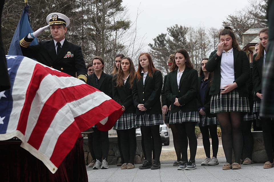 Ursuline students stood at attention in front of Benson's casket.