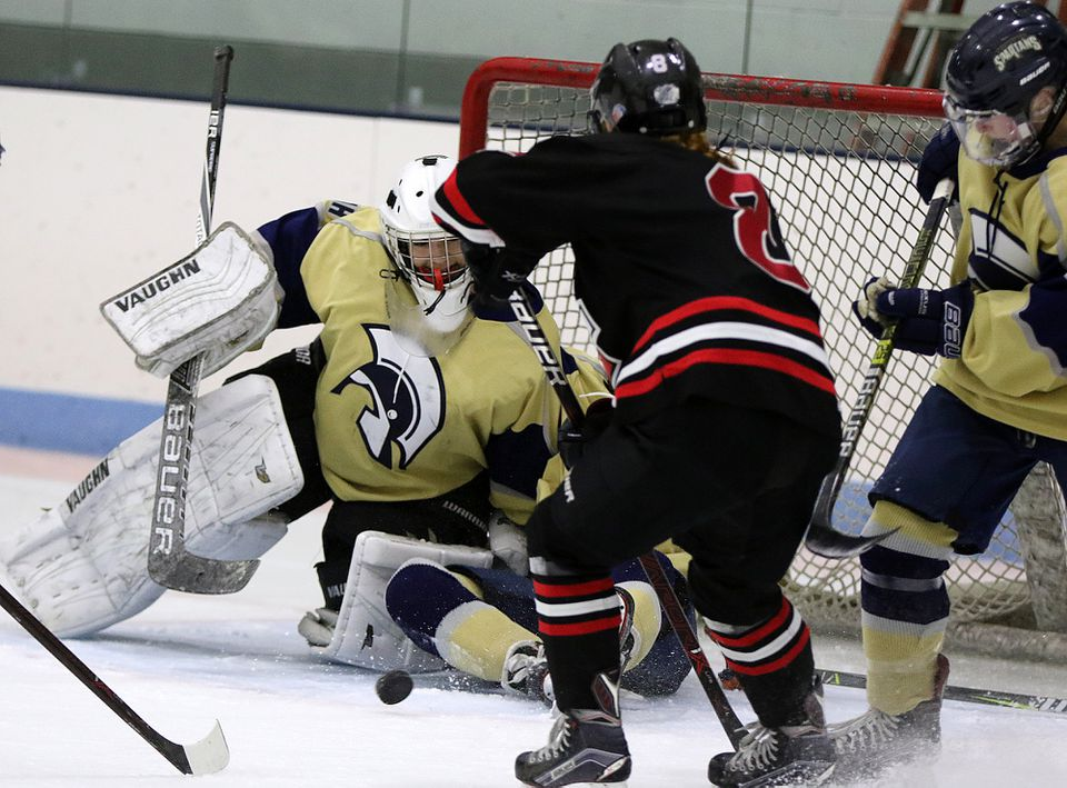 Marblehead's Cate Delaney can't sneak this shot by St. Mary's goalie Lauren Vaccaro.