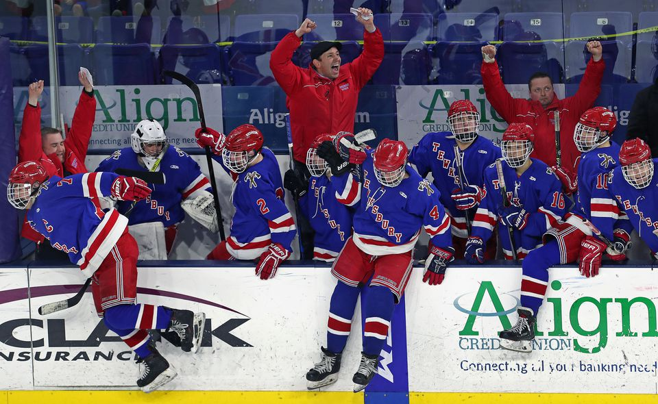The Tewksbury bench erupts as the final horn sounds on Monday at Tsongas Center in Lowell.
