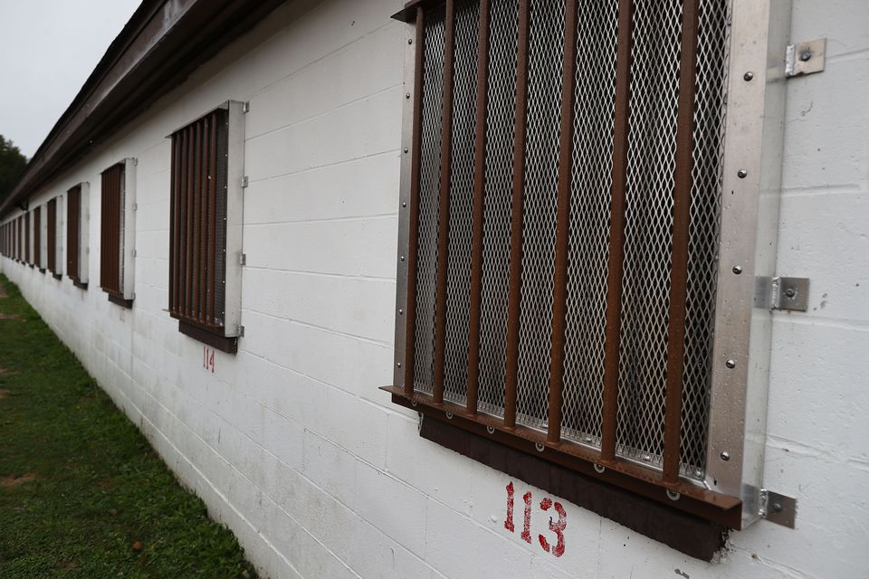 Windows for inmates' cells have bars on them.