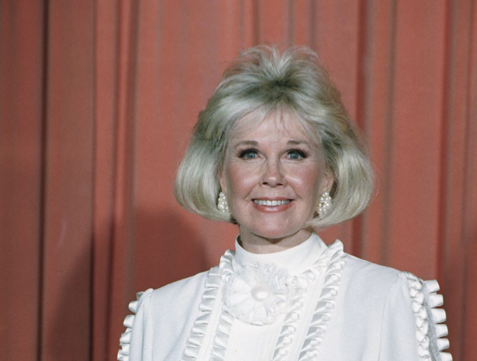 Doris Day posed after receiving the Cecil B. DeMille Award at the Golden Globe Awards in 1989.