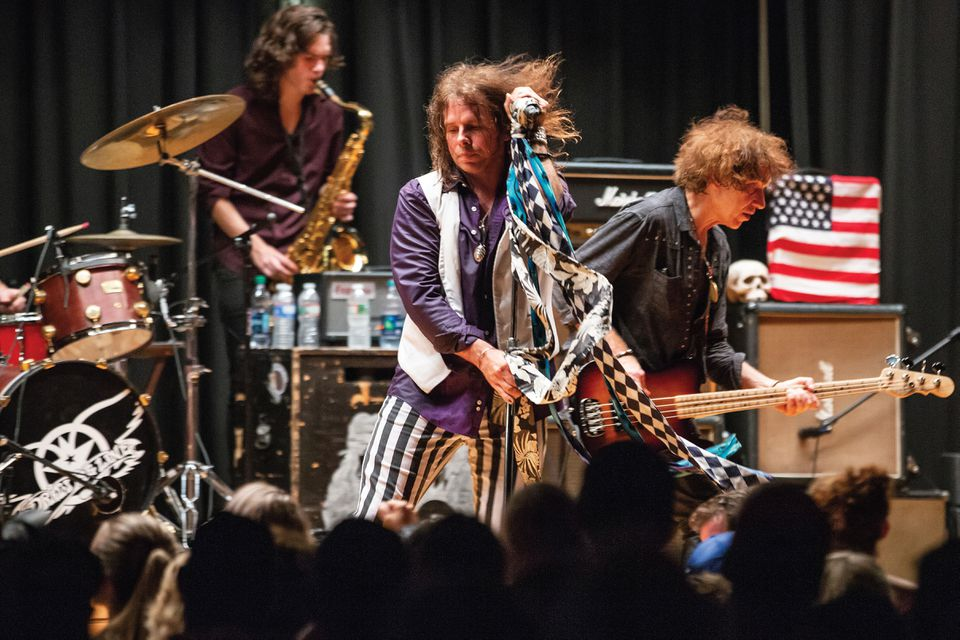 Neill Byrnes and members of Aerosmith tribute band Draw The Line, onstage at the Sherburne Gymnasium in Sunapee, New Hampshire.