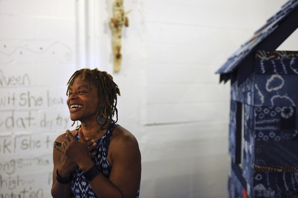 """For her Indigo Project solo exhibition, textile artist Ifé Franklin (pictured) has created an 8-foot slave cabin in patchwork adire (""""tie and dye"""") at Medicine Wheel's Spoke Gallery in South Boston."""