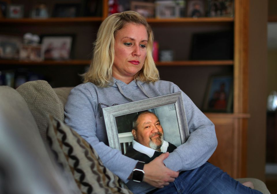 Brigitte Darton embraced a photograph of her father, William Nutter, a Vietnam combat veteran who died at the Bedford VA hospital when a nurse's aide failed to check in on him.