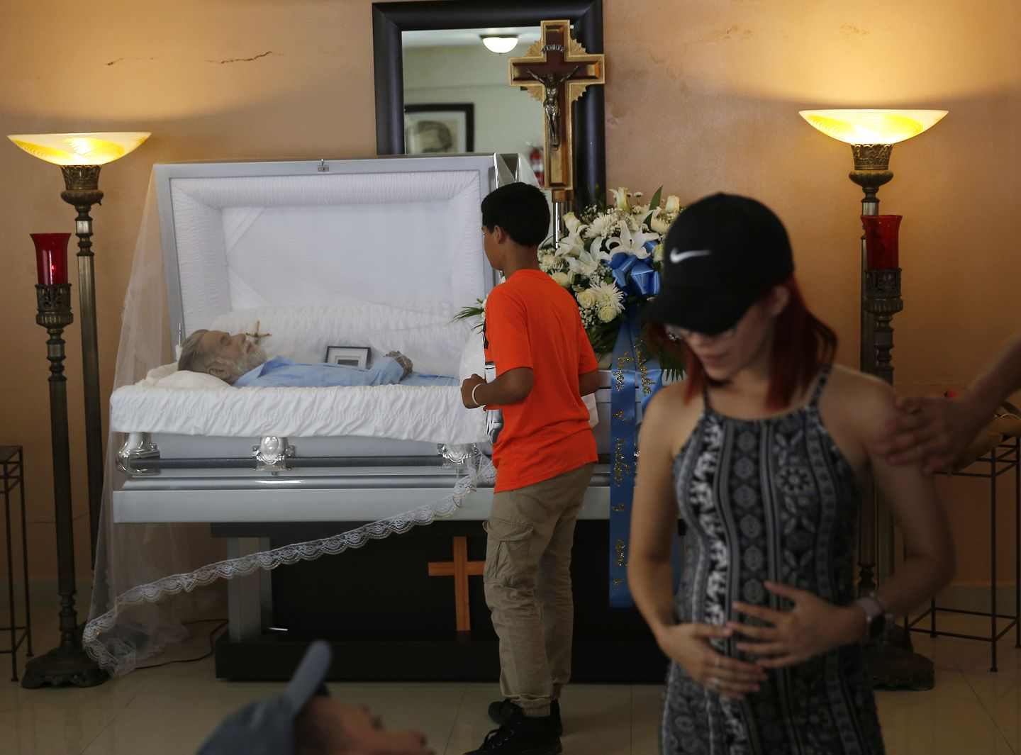 Ruiz's daughter, Kariana Ruiz, who is five months pregnant, attended the services for her father at Funeraria Hernandez.