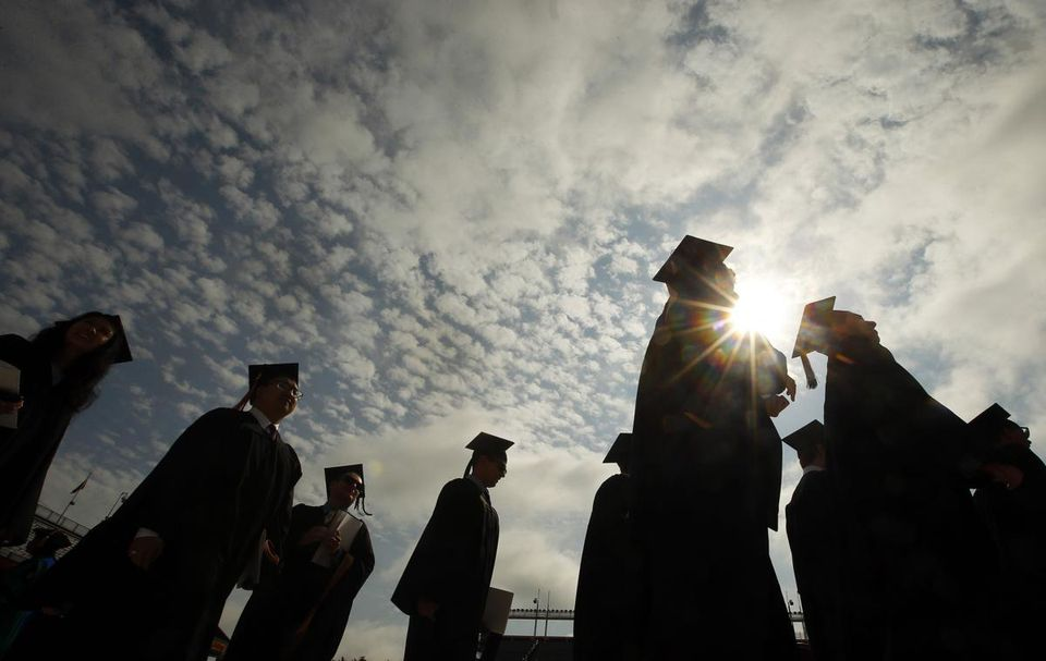 Graduating students arrived for Boston College commencement exercises in 2013.