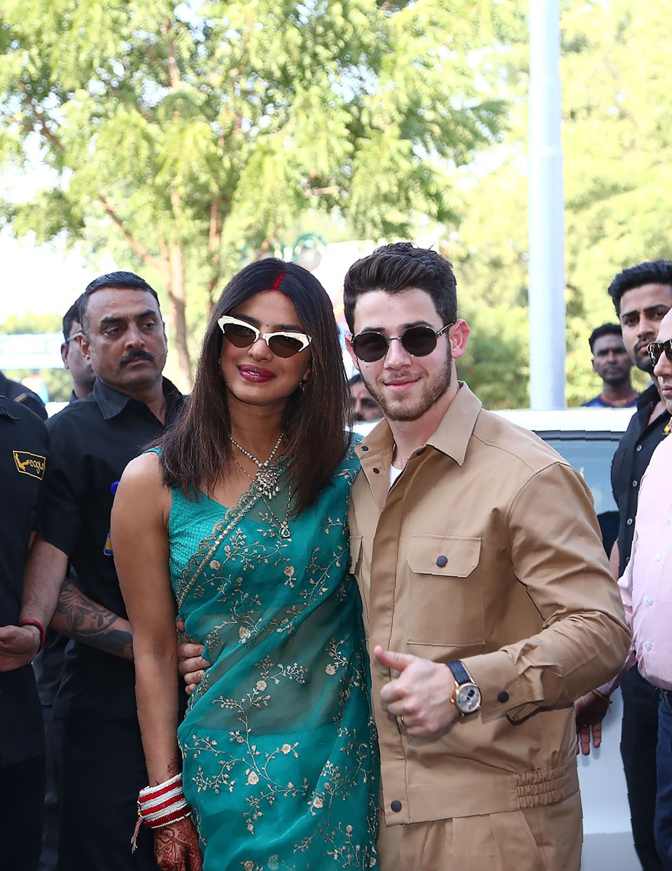 The couple posed for a photograph as they left after their wedding ceremony in Jodhpur on Dec. 3.