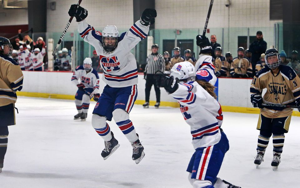 Cassidy Gruning leaps in celebration after she scored a first-period goal Tuesday. Teammate Julia Masotta (right) is about to join the party.