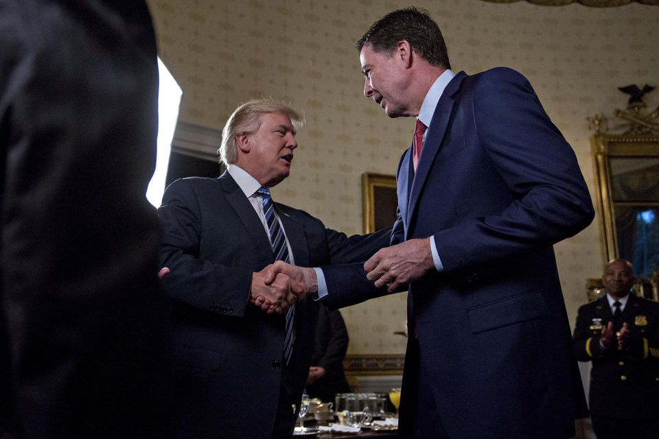 President Donald Trump shakes hands with James Comey, director of the FBI, in January.