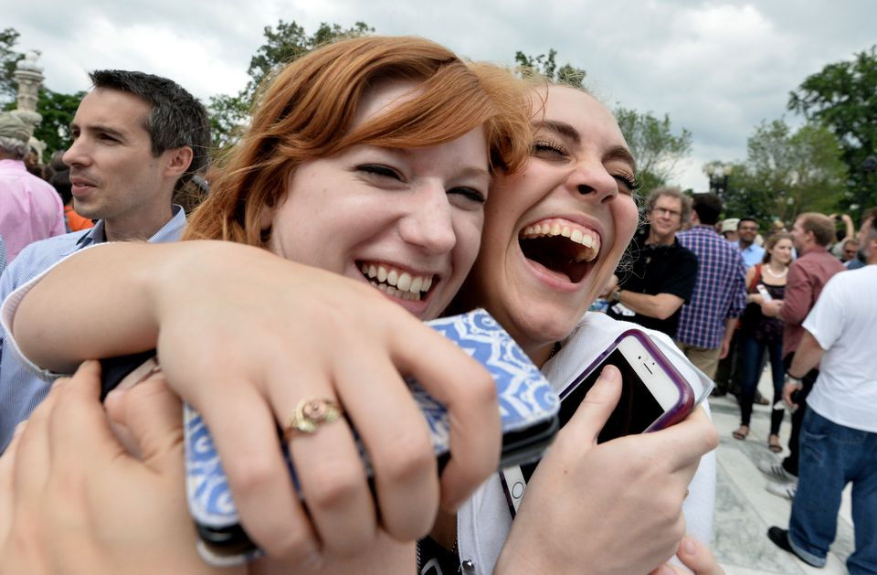 Two women celebrated outside the Supreme Court on Friday after its historic decision extending marriage equality to all 50 states.