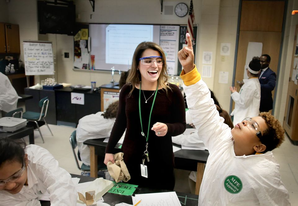 Albert Delanuez, 12, had a moment of triumph after dipping his finger in a baking soda and vinegar volcano in Zoe Pierce's sixth grade science class at Impact Prep in Springfield.