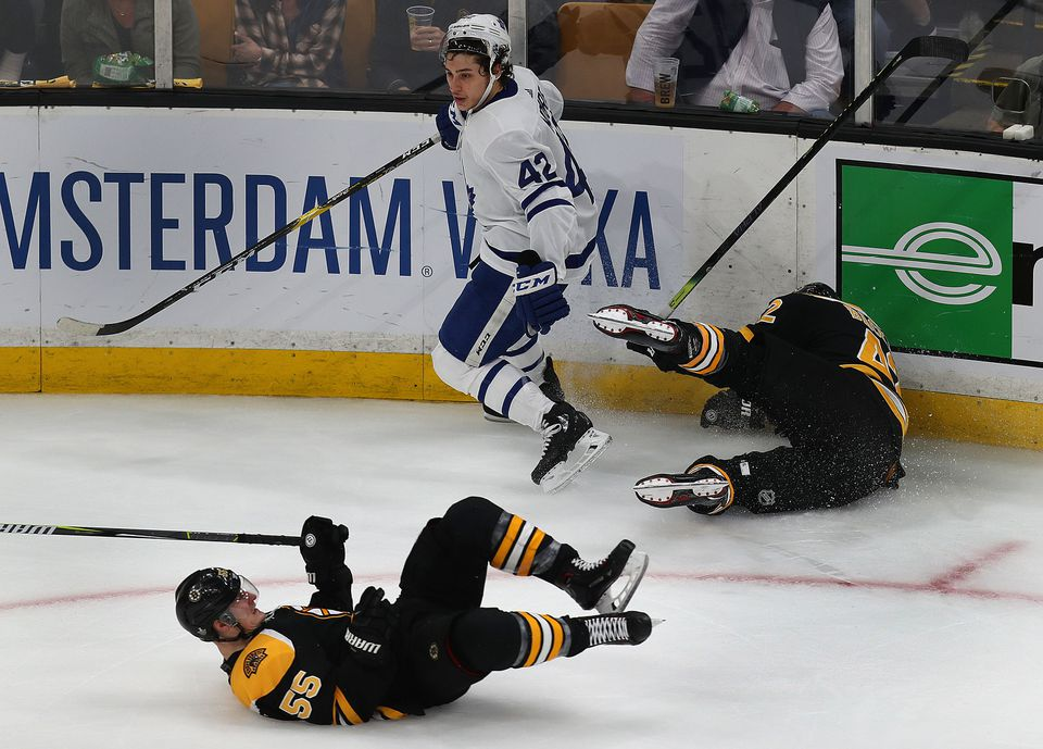Toronto's Trevor Moore was left standing after Bruins Noel Acciari (left) and David Backes collided with each other.