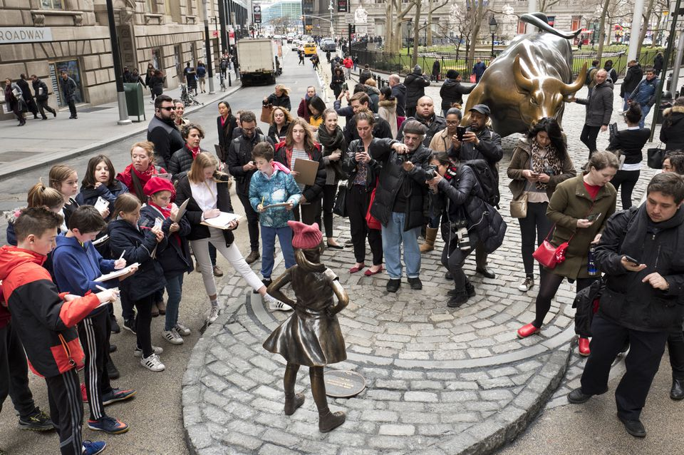 """The """"Fearless Girl"""" was the center of attention Wednesday as she faced down Wall Street's iconic charging bull."""