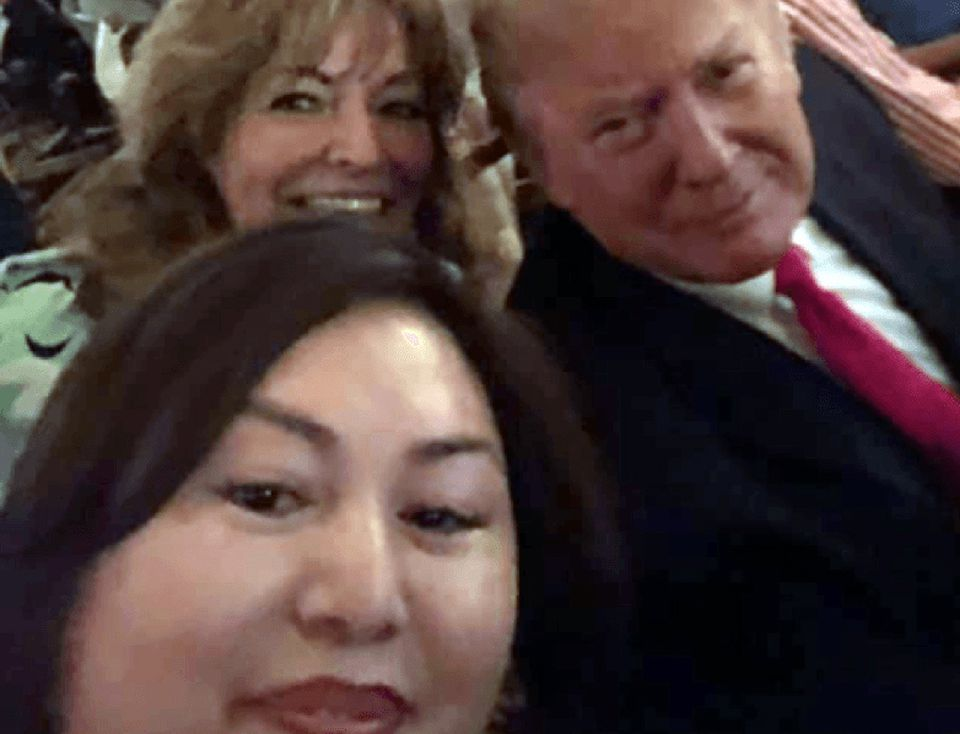 Li Yang (foreground) took a selfie with Donald Trump at a Florida Super Bowl watch party.