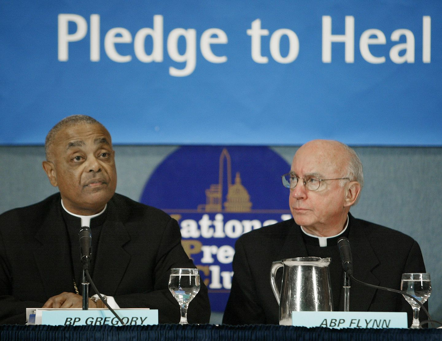 Archbishop Harry Flynn of Minneapolis-St. Paul (shown with Bishop Wilton Gregory at left in 2004) effectively handled the nation's first clergy sex abuse scandal. But he, too, would eventually be caught in the undertow.