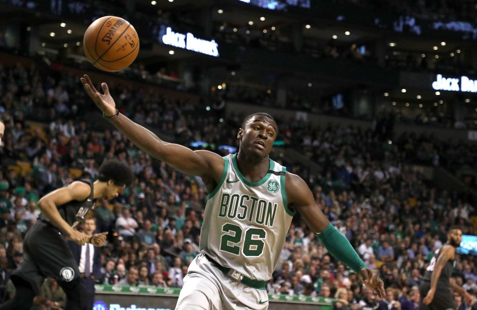 Boston Celtics Jabari Bird hauls in a defensive rebound against the Brooklyn Nets during first quarter action at TD Garden in April.