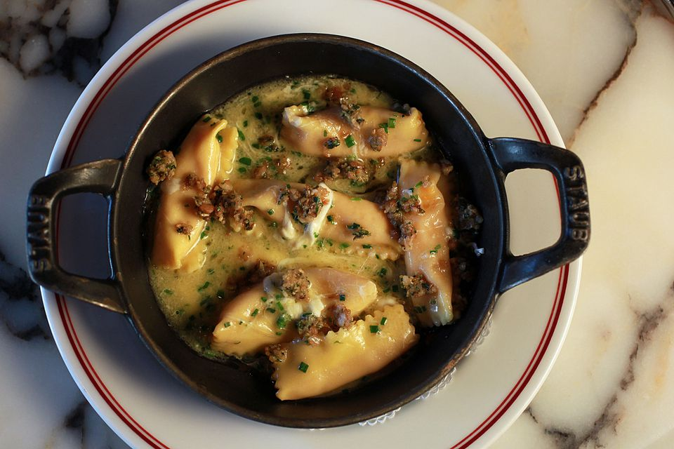 Carrot agnolotti sprinkled with pine nuts.