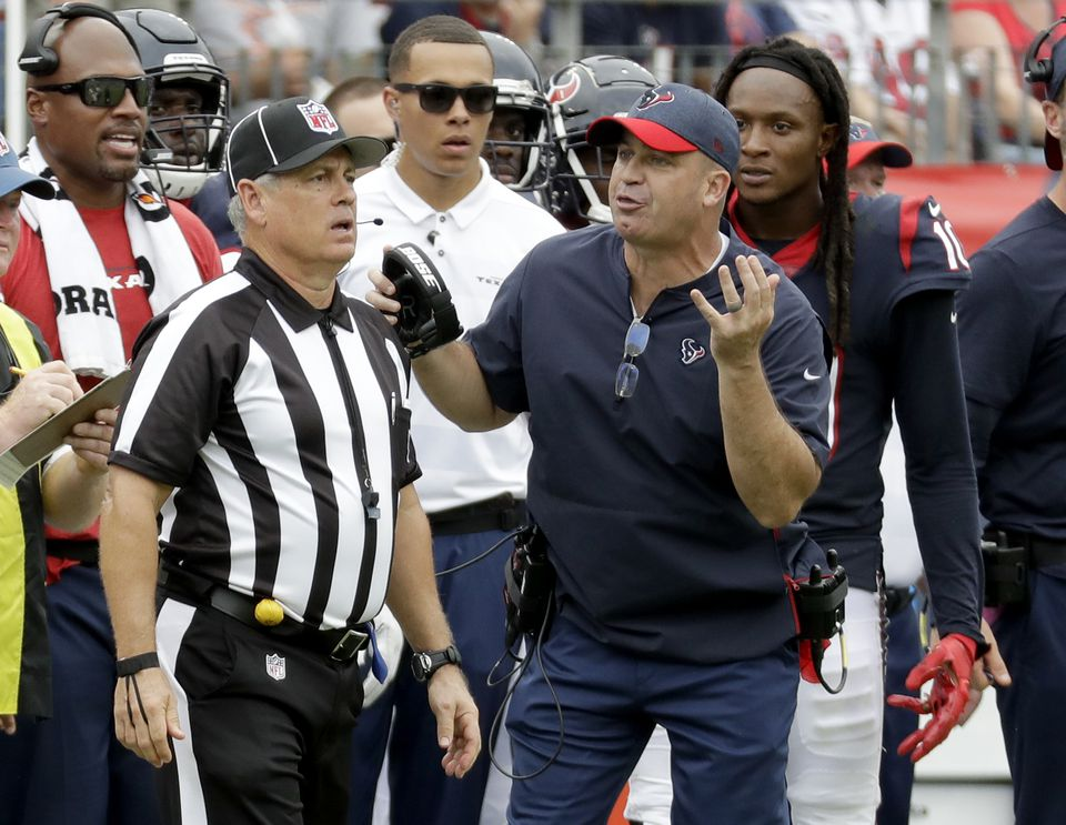 Bill O'Brien argues a call in the second half against the Titans.