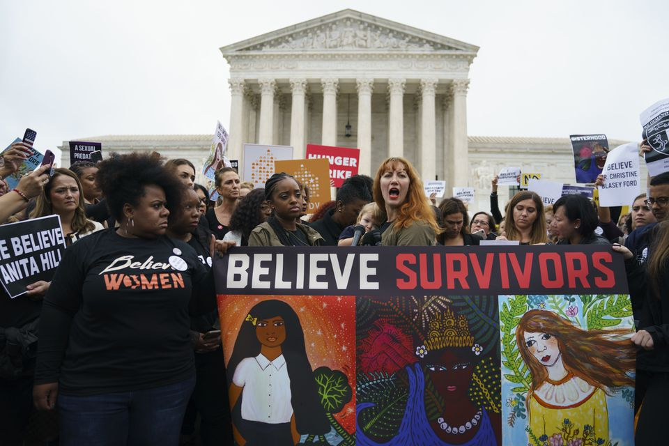 Protesters with Women's March and others gathered in front of the Supreme Court on Capitol Hill in Washington on Monday.