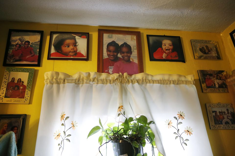 Family photos line the walls inside Marcelle Harrison's home at 6 Ashburton Place, where she has lived for almost 40 years.