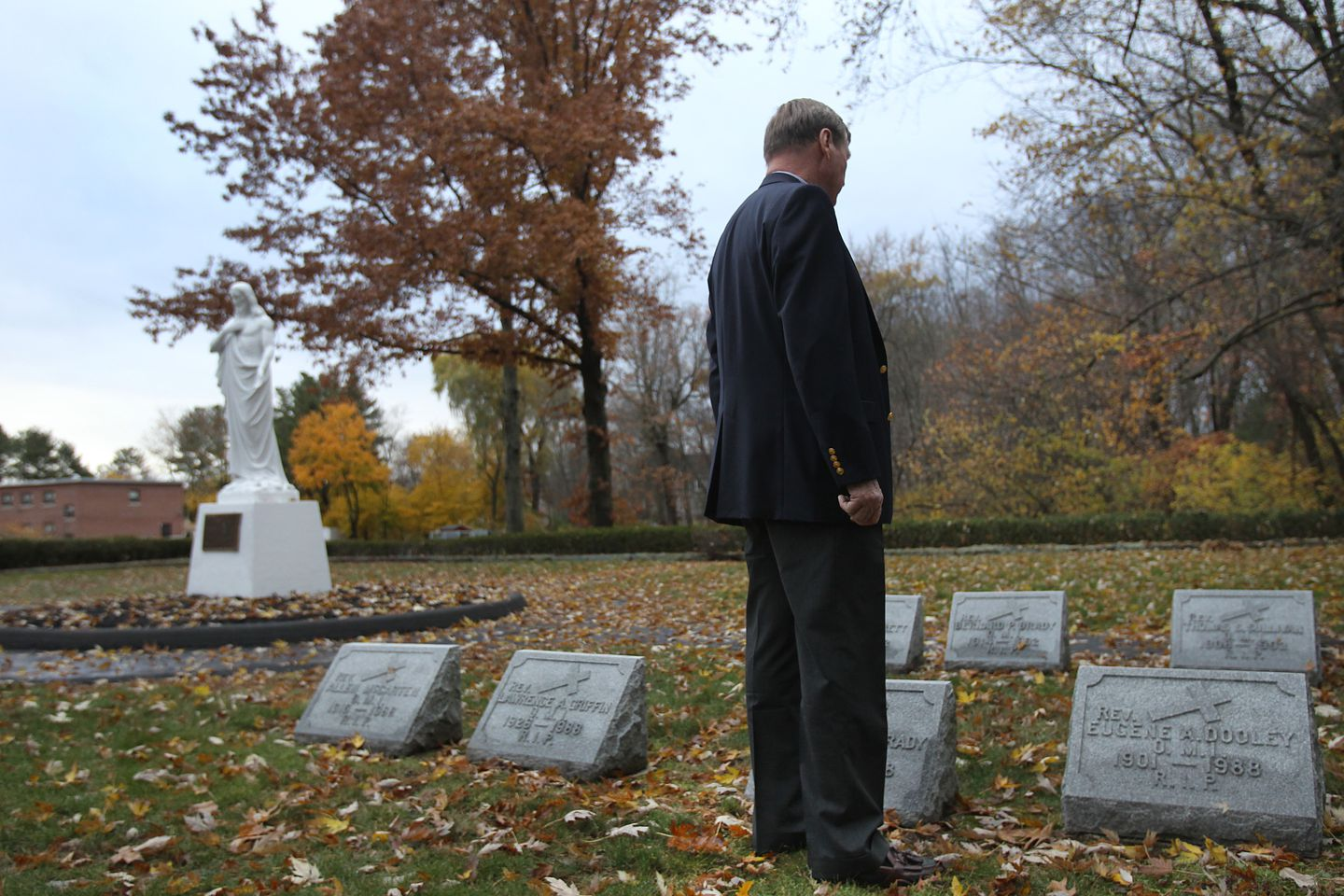 Jim Graham visited the grave of the man he believes was his father, the Rev. Thomas S. Sulllivan, in Tewksbury.