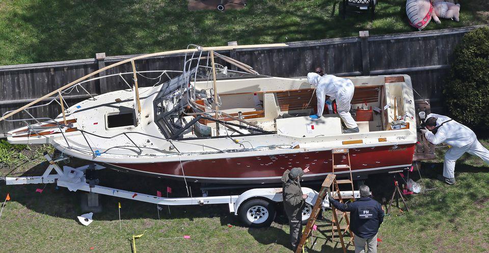 Bullet holes cover the side of the boat where Dzhokhar Tsarnaev hid.