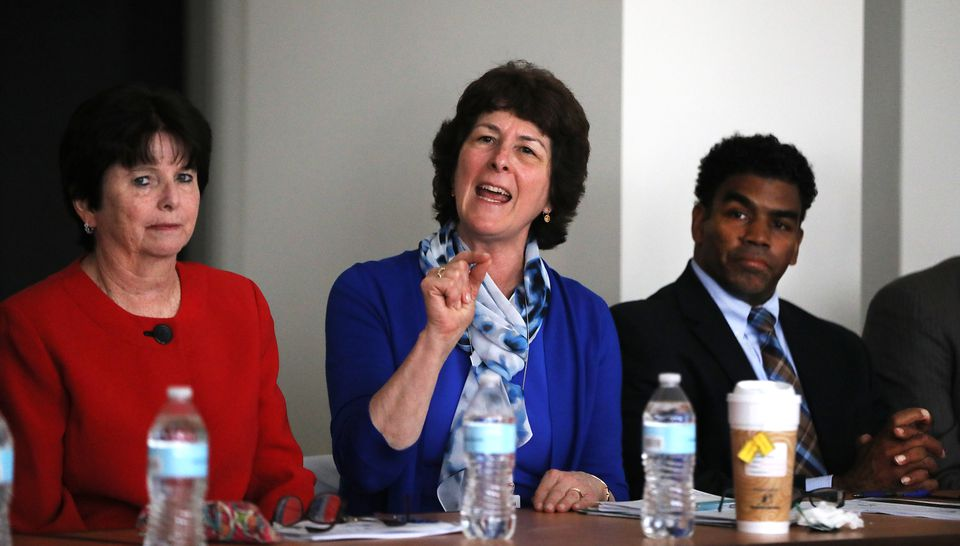 Brockton Superintendent Kathleen Smith (center) made a point about her school system's budget challenges.