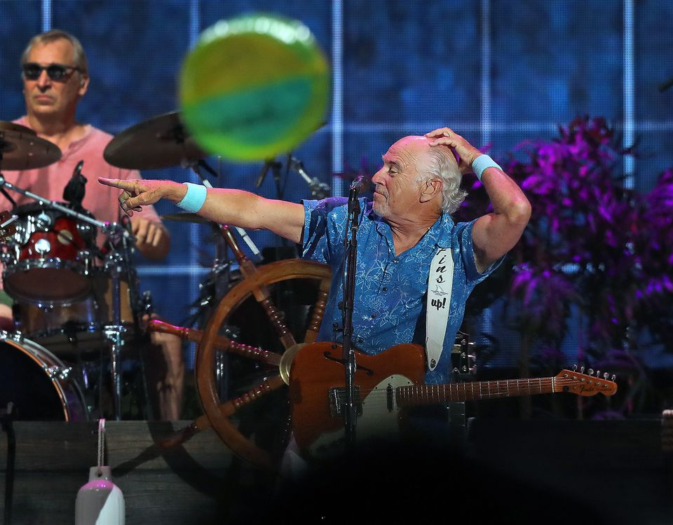 Beach balls were flying as Jimmy Buffett performed at Fenway Park.