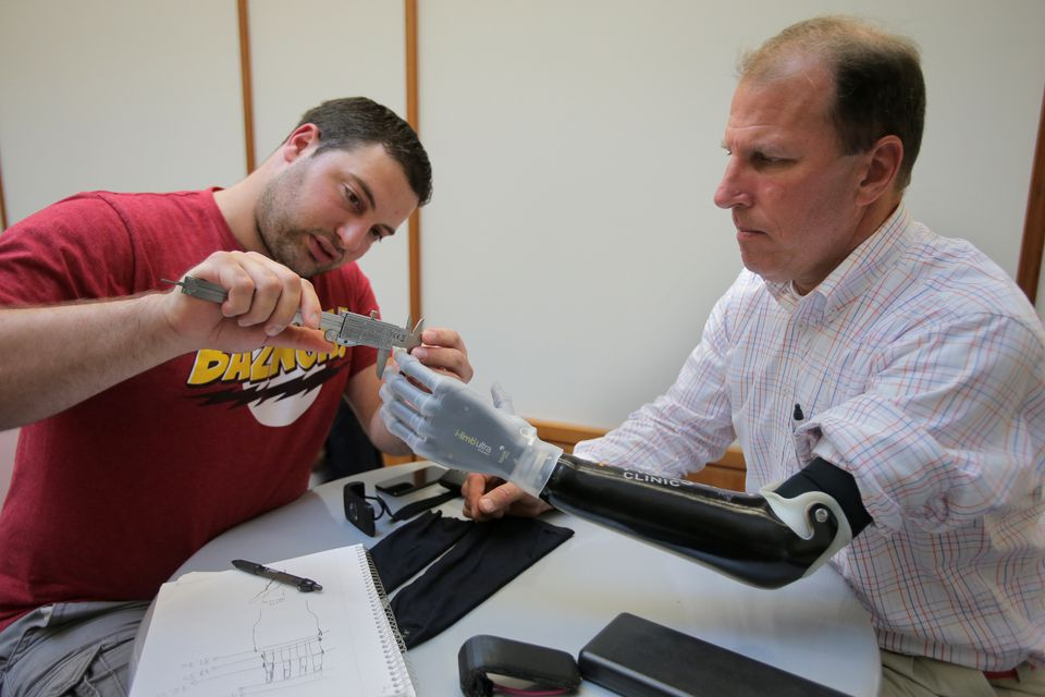 Ioannis Smanis measured Mike Benning's prosthetic arm.
