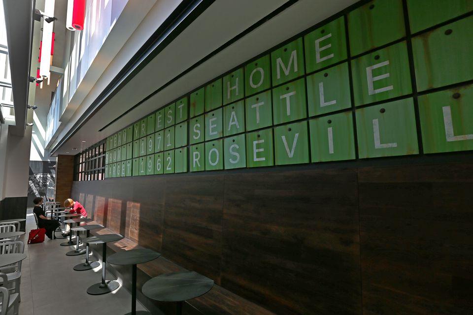 The scoreboard behind Starbucks.