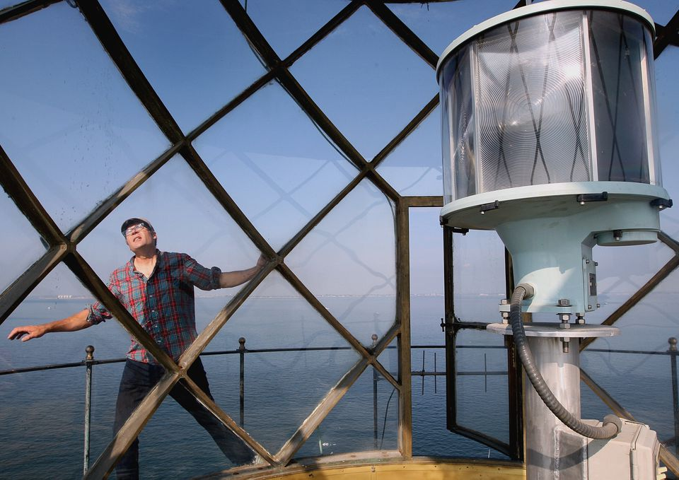 David Waller surveyed the lantern room, a glassed-in area atop the Graves Island Light Station, early this month.