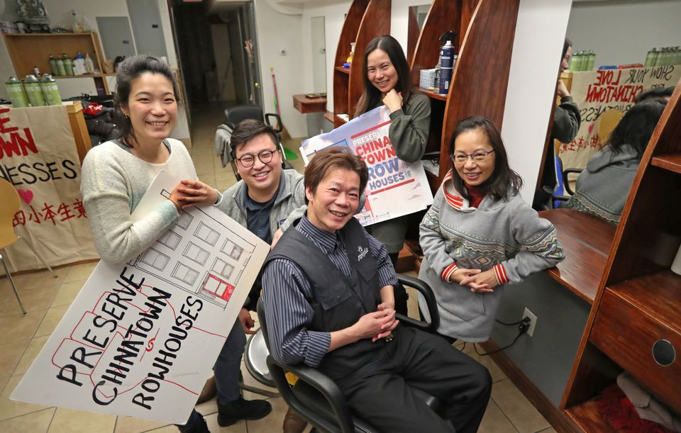 Chinatown hair salon owner Yan Chi Chen (center), sat surrounded by Chinese Progressive Association staff members after Chen settled with his landlord out of court and avoided displacement.