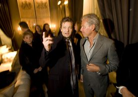 Actor Jeremy Renner (left) and Restoration Hardware's creator and curator Gary Friedman at the store's opening gala.