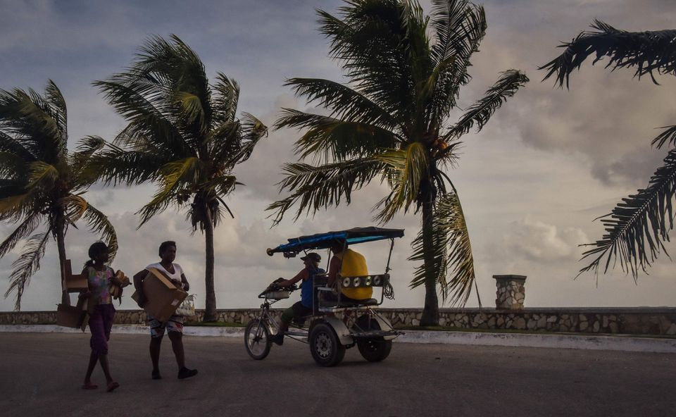 Cubans carried their belongings Friday in Caibarien, the only town in the Cuban north central zone under a hurricane warning.