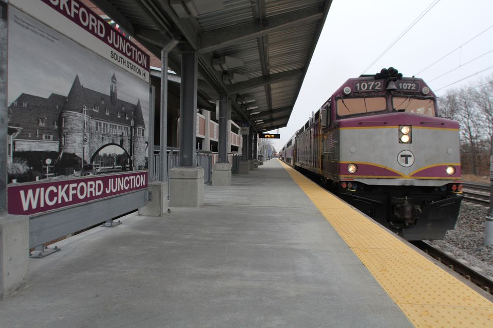 A commuter rail train approaches the station in Wickford Junction, R.I. Rhode Island officials would like to see the MBTA launch express trains from the state to Boston — a move the T says would be difficult to pull off.