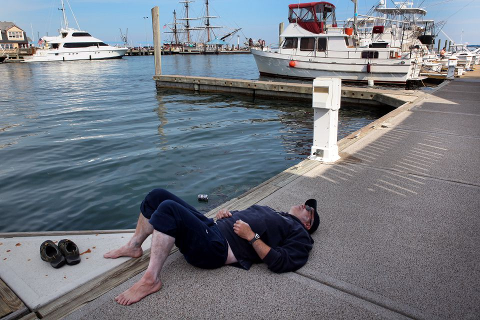 Greg O'Connor rested in Provincetown on Tuesday after nearly 10½ hours in the water.